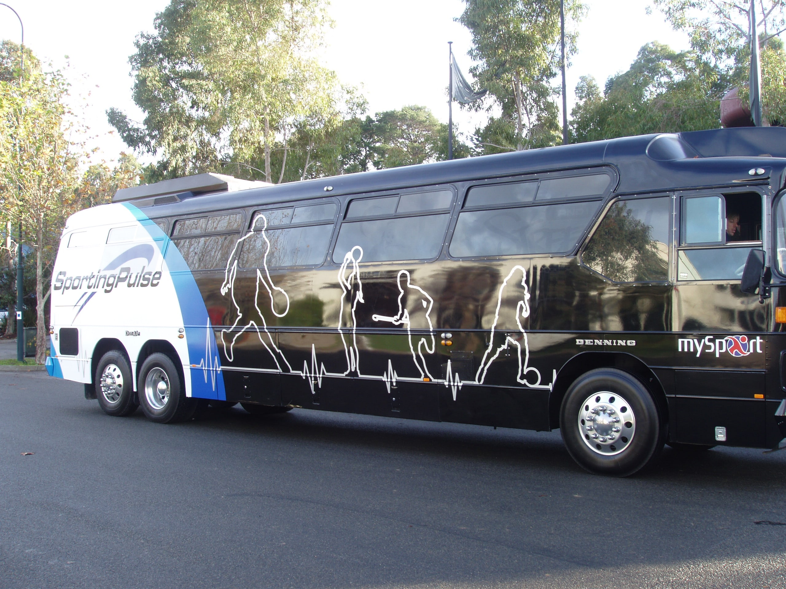 Sporting pulse bus vehicle signage side view