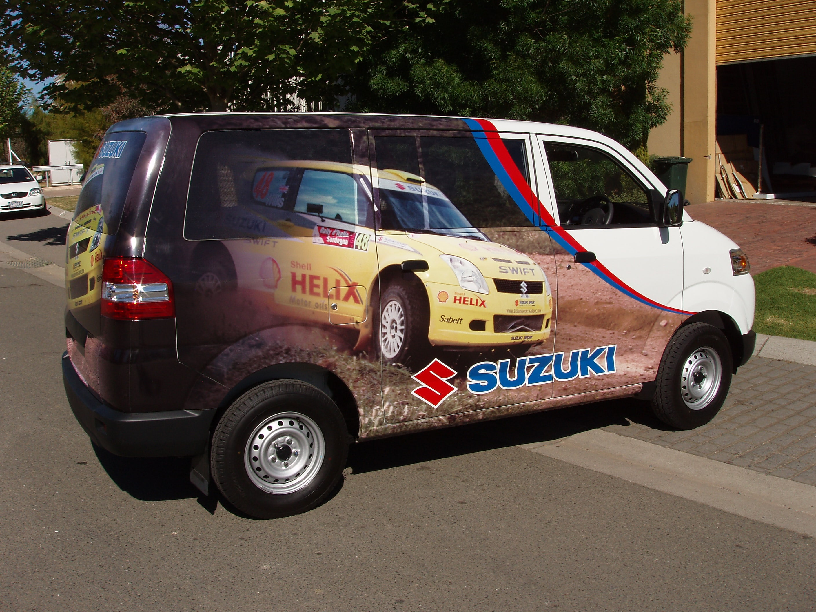 Van team Suzuki vehicle signage right side view