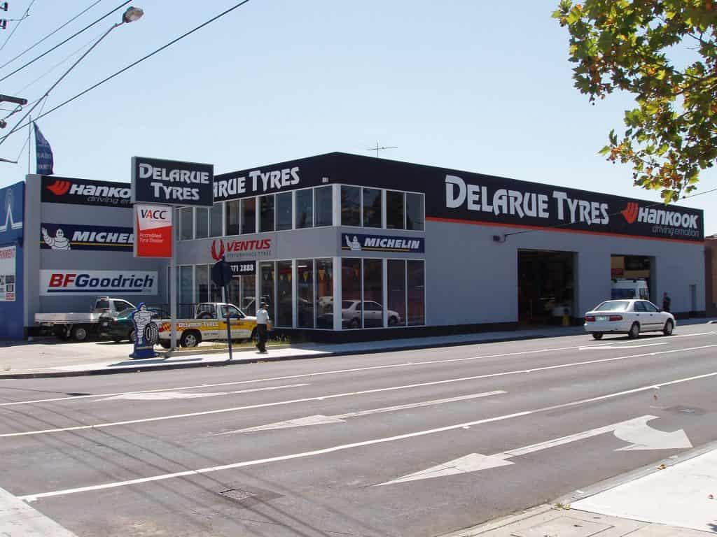 Shop front building signage Delarue tyres Hankook