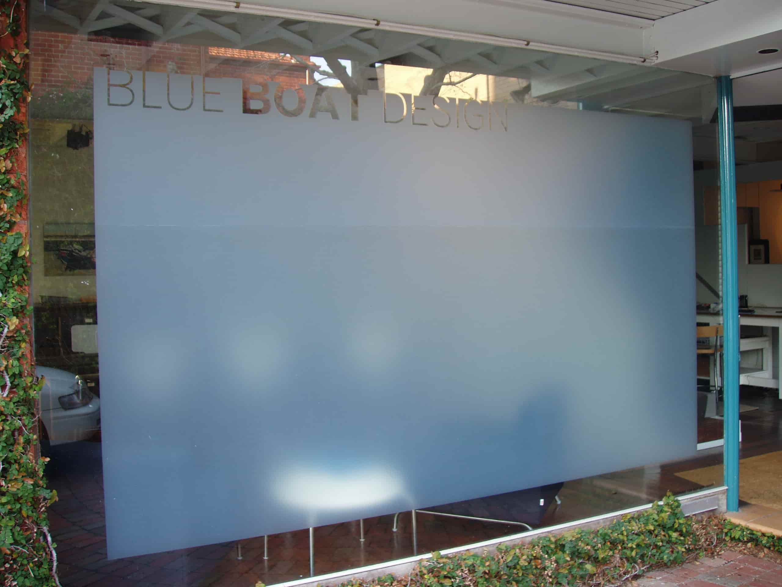 blue boat design shop front signs